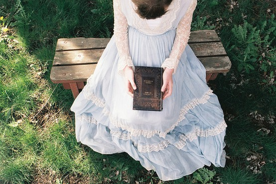 reading book on bench