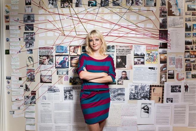"""Lauren Beukes in front of her """"murder wall"""". http://laurenbeukes.com/"""